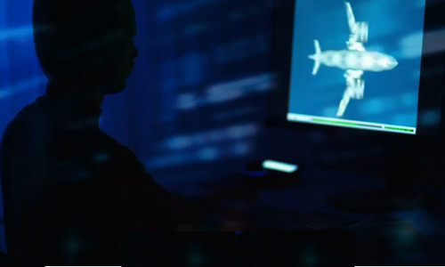 An engineer observing flow physics of aircraft design on a computer display.